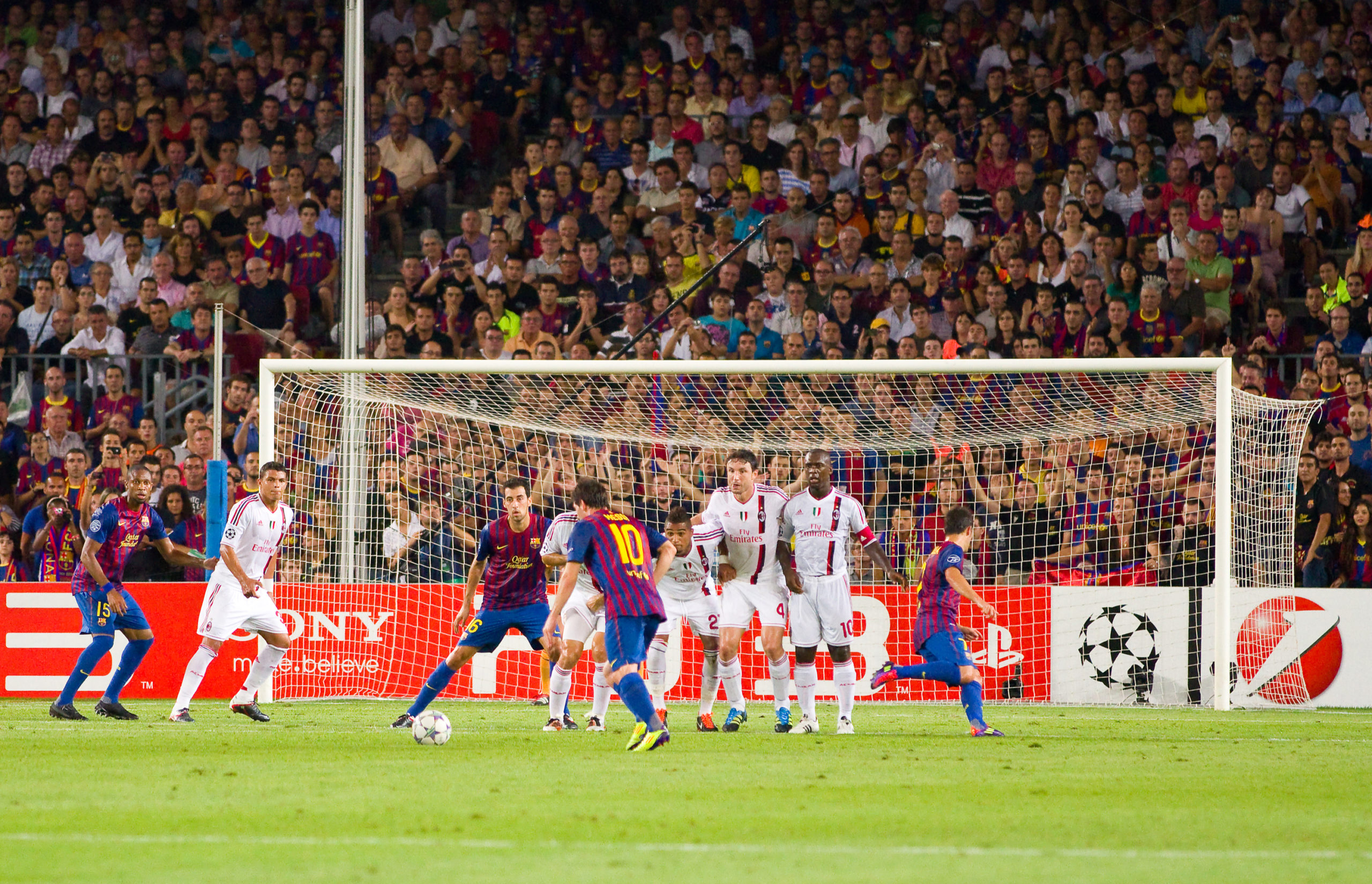 Best soccer free kick taker Lionel Messi shooting a soccer free kick
